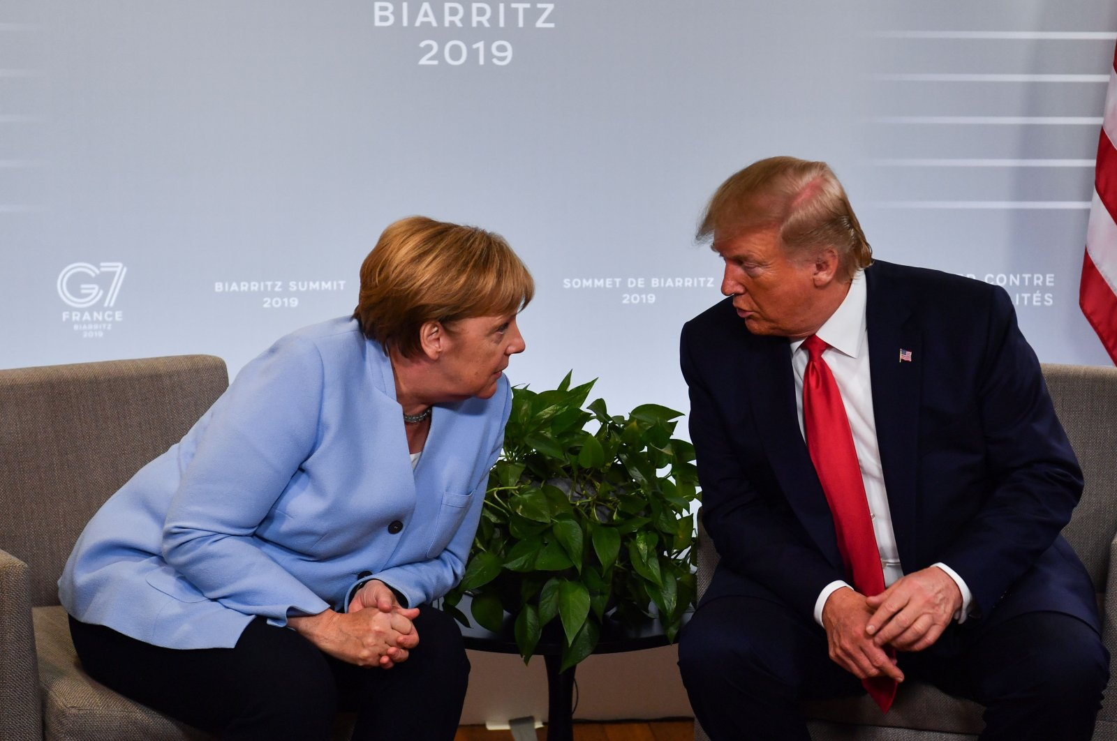 German Chancellor Angela Merkel (L) and U.S. President Donald Trump speak during a bilateral meeting on the sidelines of a Group of Seven summit in Biarritz, southwestern France, Aug. 26, 2019. (AFP Photo)