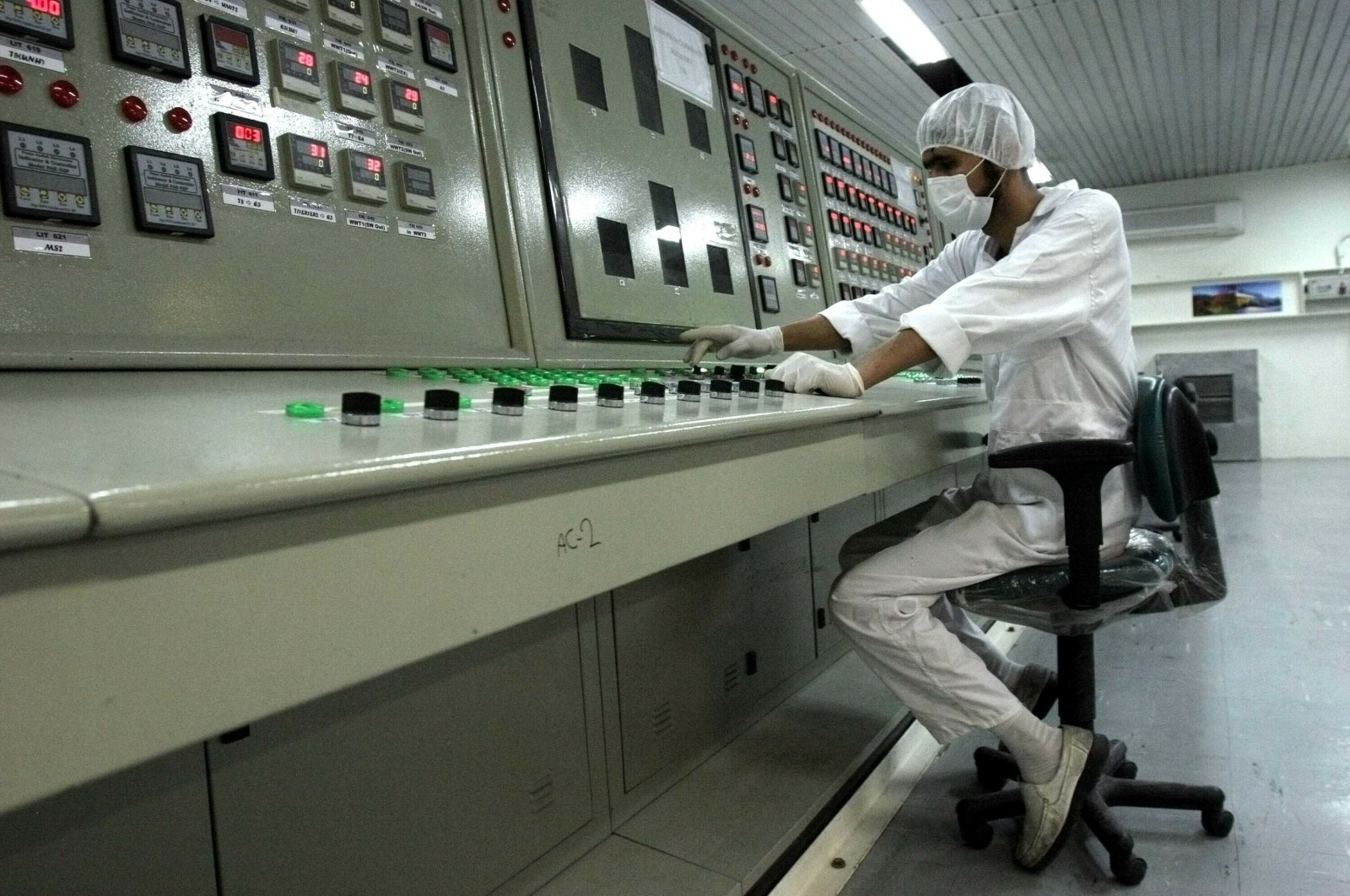 An Iranian technician works at the Uranium Conversion Facility just outside the city of Isfahan, Iran, Feb. 3, 2007. (AP Photo)