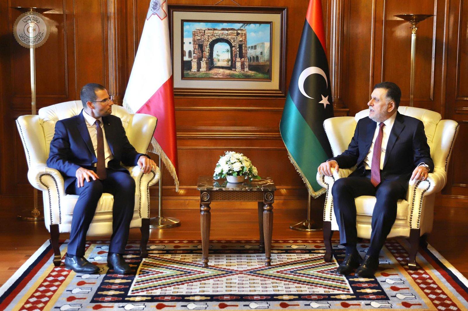 Malta's Prime Minister Robert Abela (L) speaks with Libyan counterpart Fayez Sarraj during a bilateral meeting in Valetta, Malta, May 28, 2020. (AA Photo)