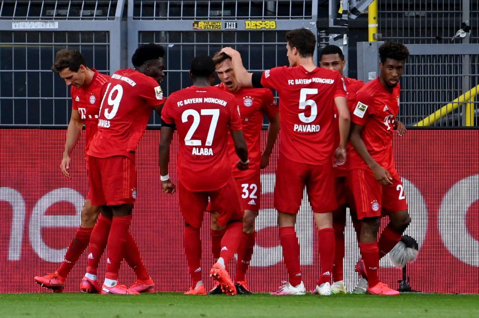 Joshua Kimmich (C) of Bayern Munich celebrates with teammates after scoring the 0-1 goal during a match between Borussia Dortmund and FC Bayern Munich at Signal Iduna Park in Dortmund, Germany, May 26, 2020. (EPA Photo)