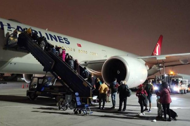 Photo shared by the German Federal Foreign Office's Twitter account shows German and Turkish citizens boarding a Turkish Airlines evacuation plane on Monday, May 25, 2020.
