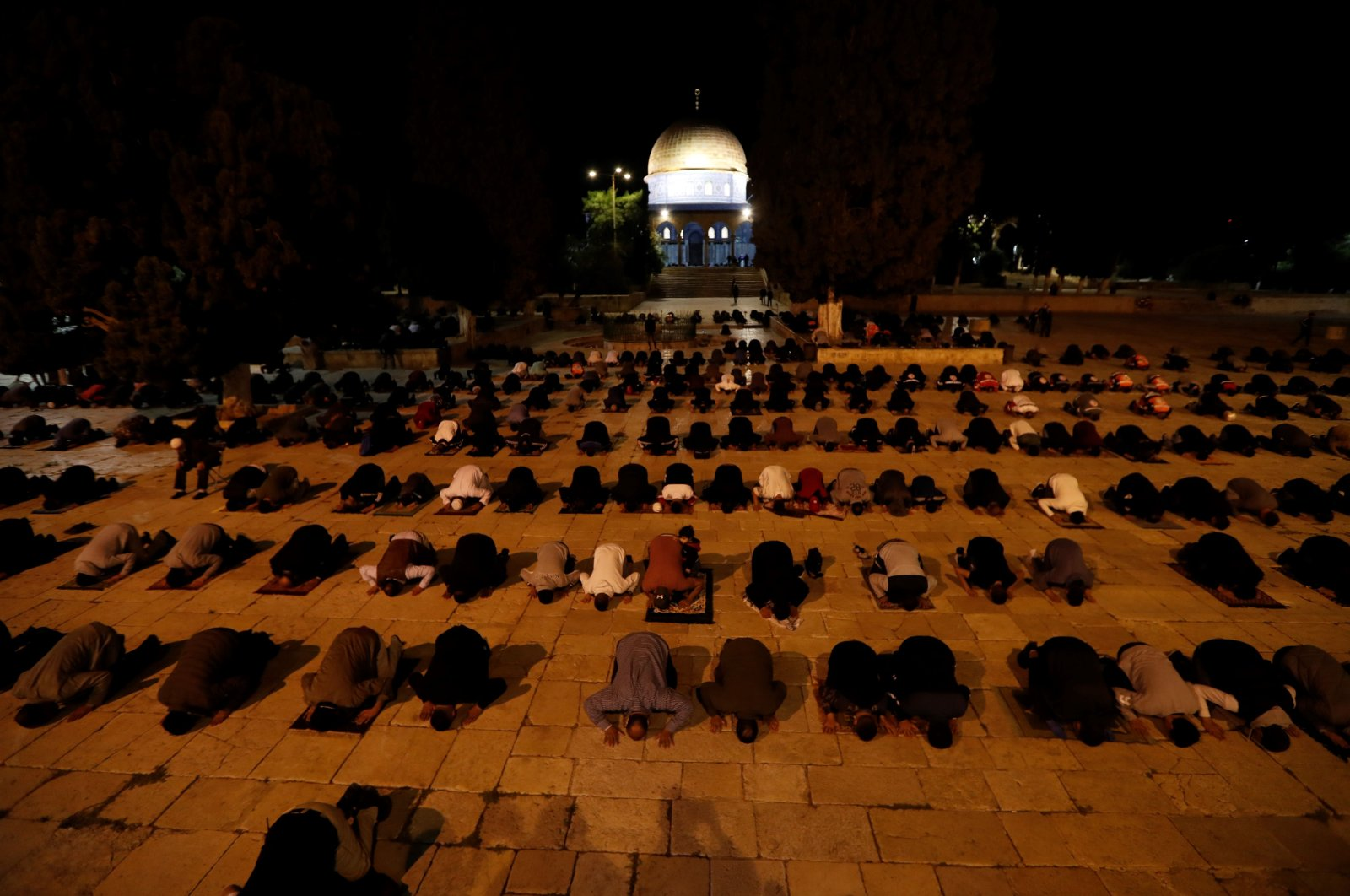 Palestinian worshippers pray at the al-Aqsa mosque compound, Islam's third holiest site, in Jerusalem's Old City on June 1, 2020,  after a two-month closure due to the COVID-19 pandemic. (AFP Photo)