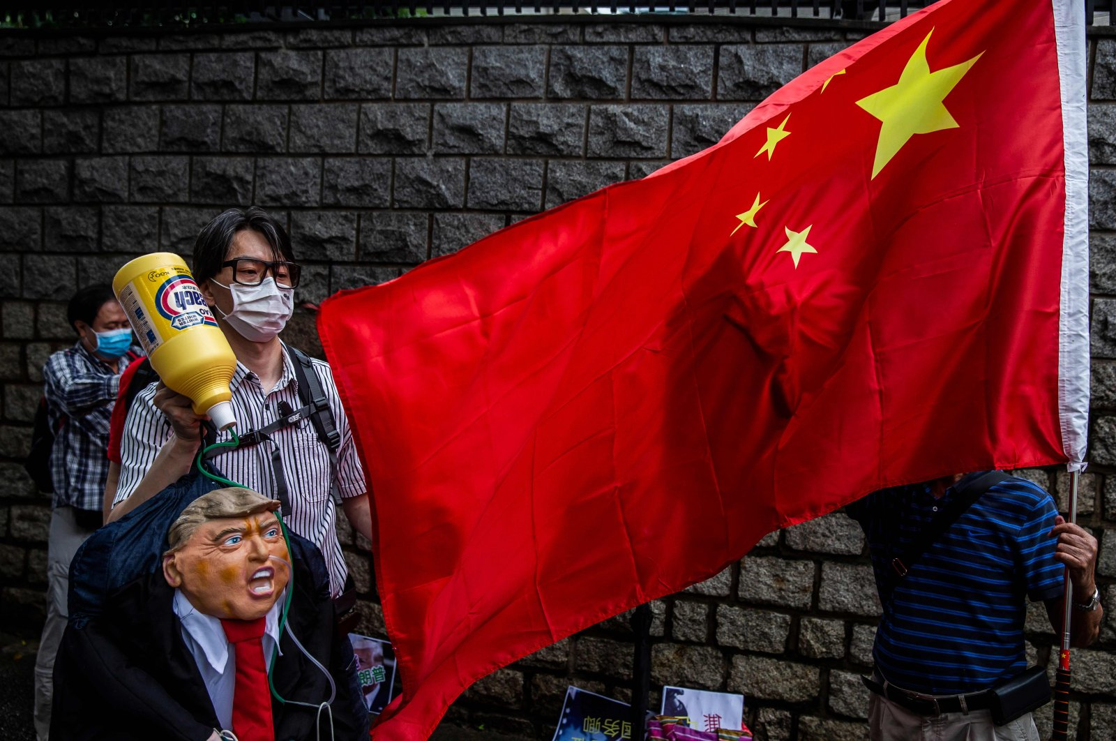 A pro-China activist holds an effigy of U.S. President Donald Trump during a protest outside the U.S. consulate in Hong Kong, May 30, 2020. (AFP Photo)