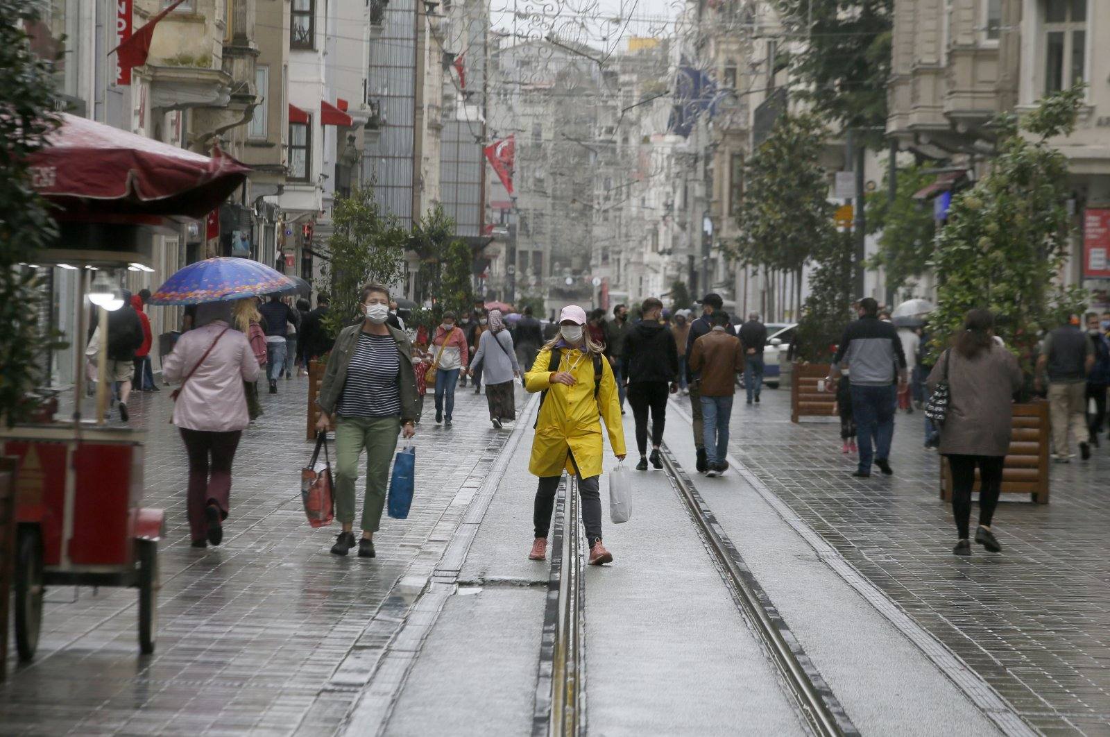 People walk on Istiklal Street in Taksim, Istanbul, Wednesday, May 27, 2020. (AA Photo)