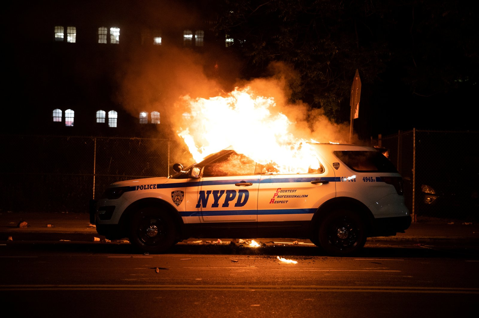 A New York City police car is set on fire as protesters clash with police during a march against the death in Minneapolis police custody of George Floyd, Brooklyn borough, New York City, U.S., May 30, 2020. REUTERS