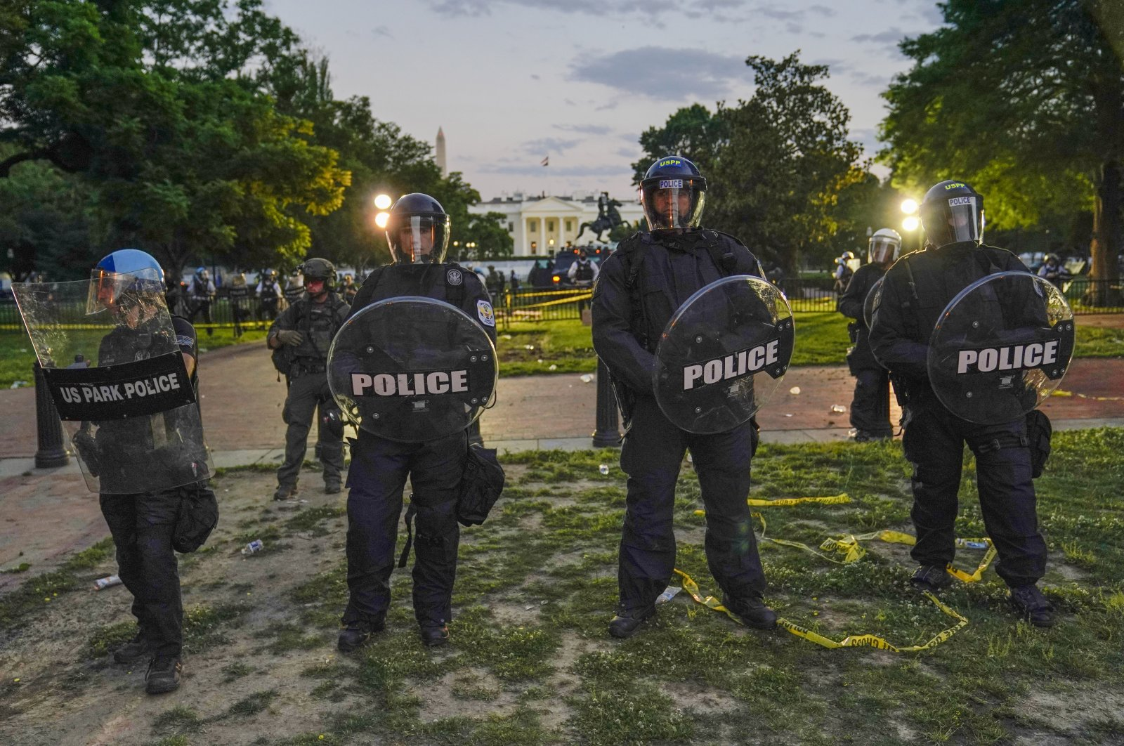 Police in riot gear stand in front of the White House as demonstrators gather to protest the death of George Floyd, Saturday, May 30, 2020, outside the White House in Washington. (AP Photo)