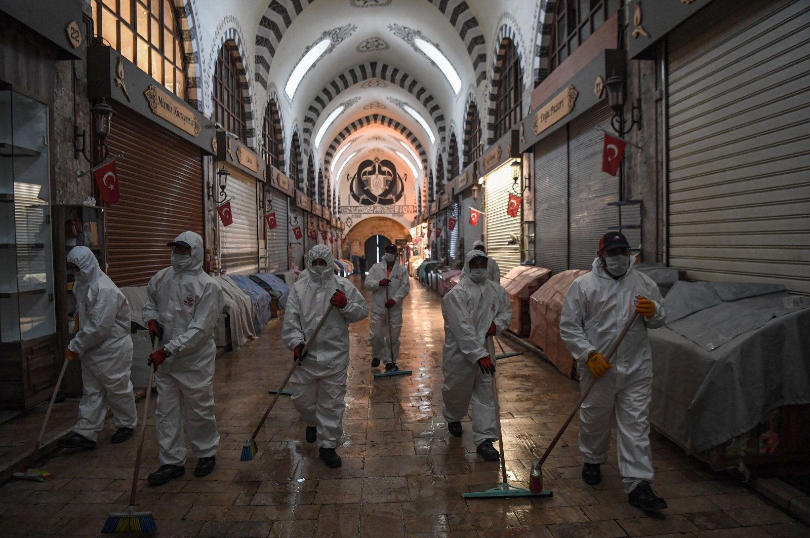 Fatih Municipality workers wearing personal protective equipment (PPE) disinfect the iconic Spice Bazaar to prevent the spread of the COVID-19, Istanbul, Turkey, May 28, 2020. (AFP Photo)