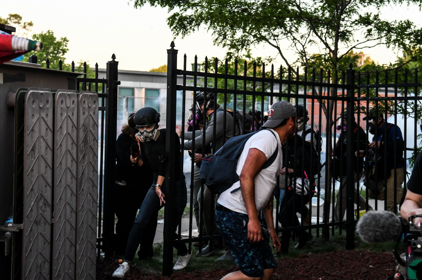 Protestors and media personnel run to take cover as police start firing tear gas and rubber bullets near the 5th police precinct following a demonstration to call for justice for George Floyd, in Minneapolis, Minnesota, U.S., May 30, 2020. (AFP Photo)