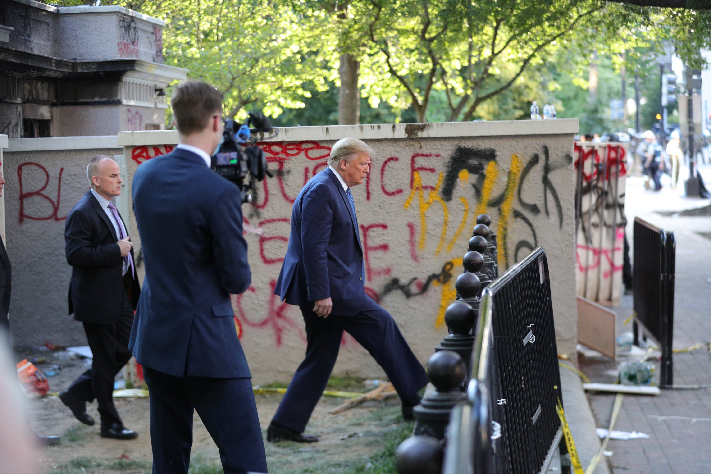 U.S. President Donald Trump walks past graffiti to visit St. John's Episcopal Church across from the White House in Washington, U.S., June 1, 2020. (Reuters Photo)