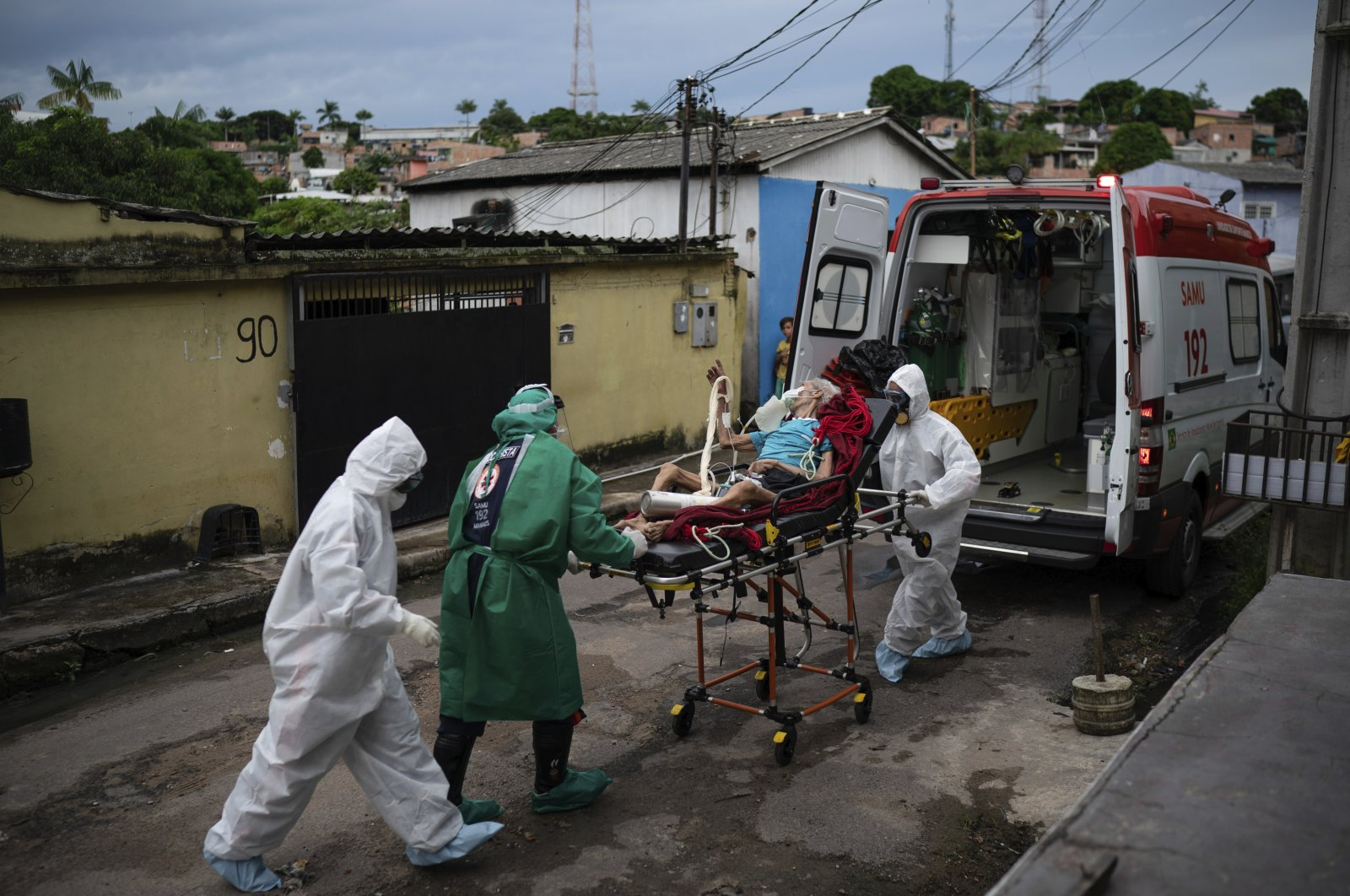 Emergency workers transfer an elderly patient, suspected of having COVID-19, to a hospital in Manaus, Brazil, Wednesday, May 13, 2020. (AP Photo)