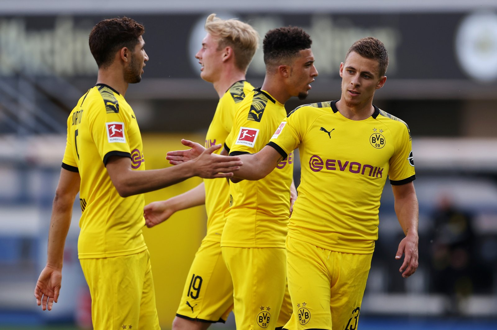 Thorgan Hazard (R) of Borussia Dortmund celebrates with teammates, scoring the 1-0 lead during a match against SC Paderborn 07, Paderborn, Germany, May 31, 2020. (EPA Photo)