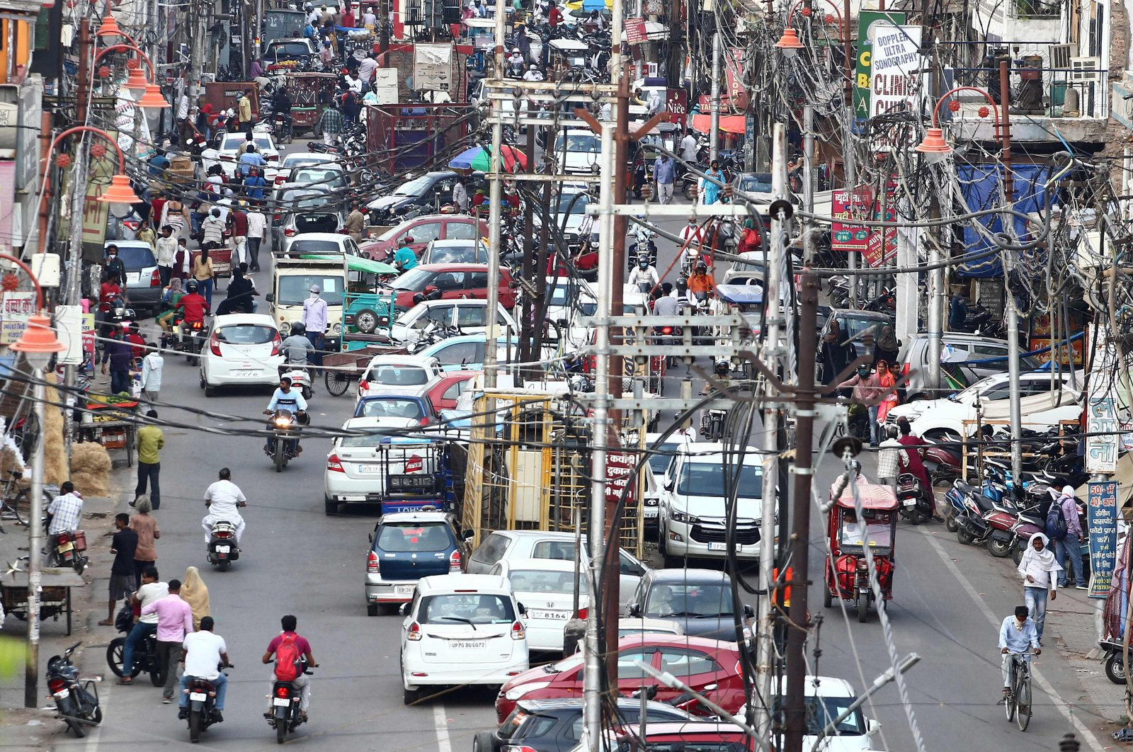 Commuters are seen along a road in the old City Chowk area after the government eased restrictions imposed as a preventive measure against the COVID-19 coronavirus, Allahabad, June 1, 2020. (AFP Photo)