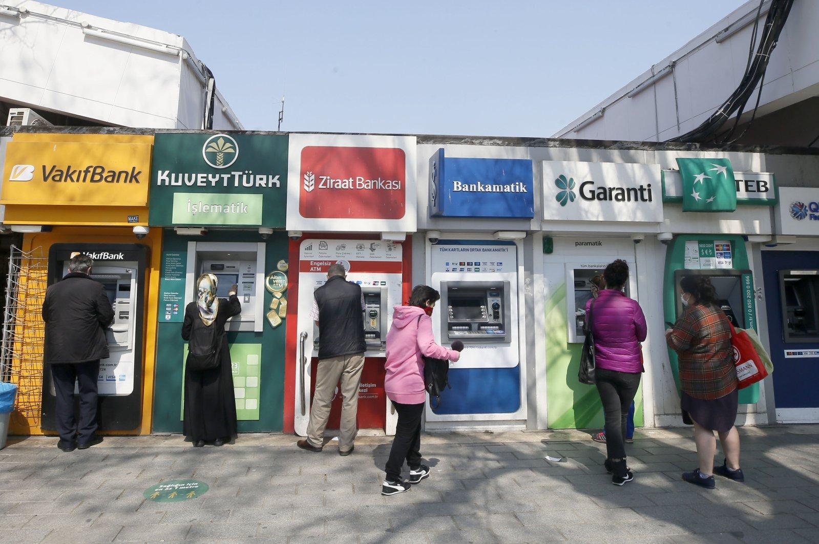 Customers use ATM machines in Istanbul's Üsküdar district, April 27, 2020