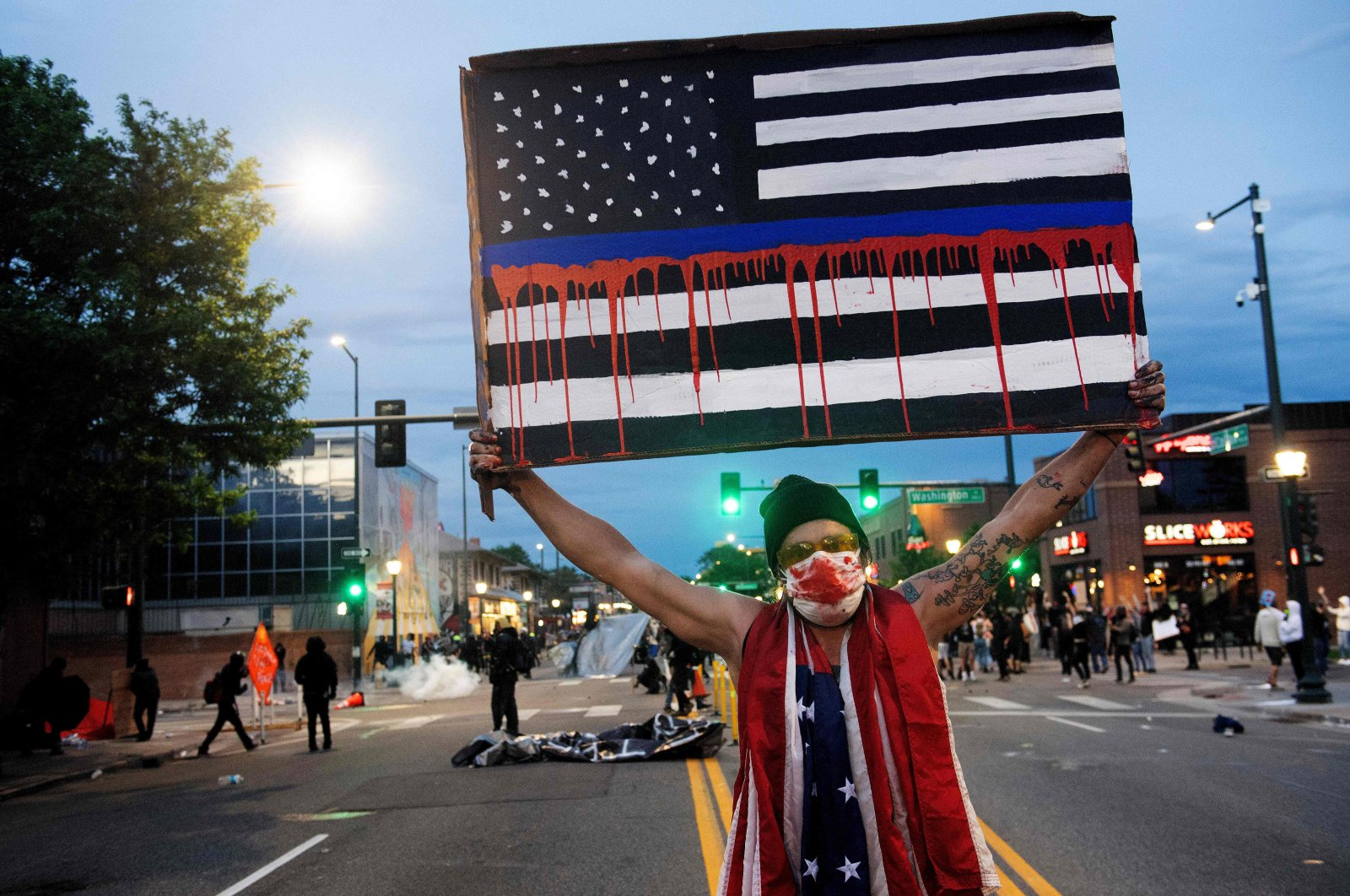 A demonstrator holds up a sign during a protest, Denver, May 31, 2020. (AFP Photo)