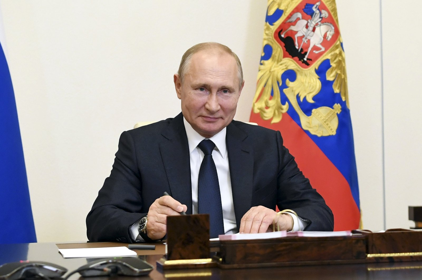 Russian President Vladimir Putin attends a meeting via teleconference at the Novo-Ogaryovo residence outside Moscow, Russia, June 1, 2020. (Kremlin Pool Photo via AP)
