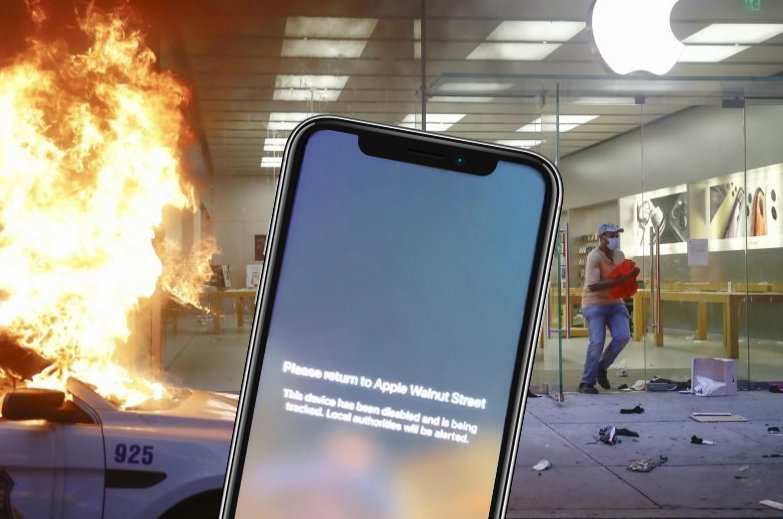 A looter leaves the Apple Store as a police car burns during the Justice for George Floyd Philadelphia Protest in Philadelphia, May 30, 2020. (AP Photo)