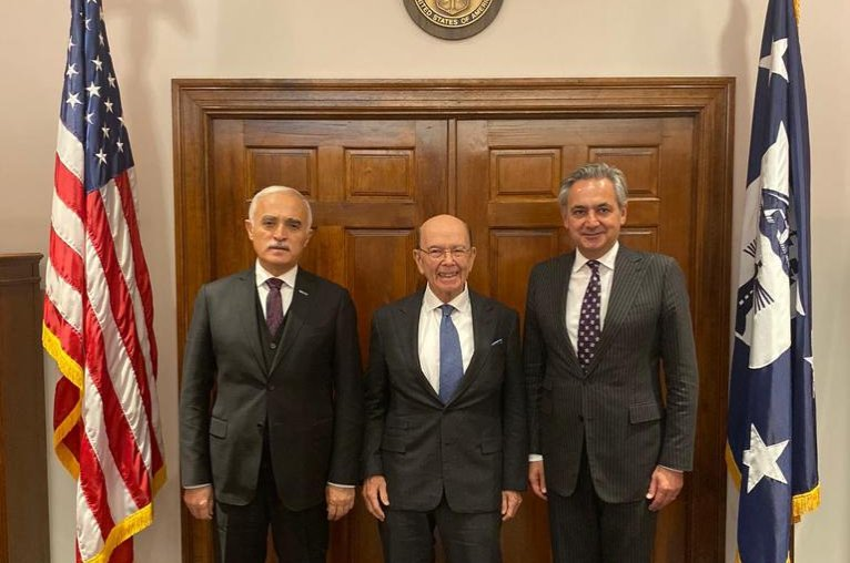 Foreign Economic Relations Board of Turkey (DEIK) Chairman Nail Olpak (L) and Turkey-U.S. Business Council (TAIK) Chairman Mehmet Ali Yalçındağ (R) pose with the U.S. Secretary of Commerce Wilbur Ross after a meeting in Washington, U.S., Nov. 13, 2019.