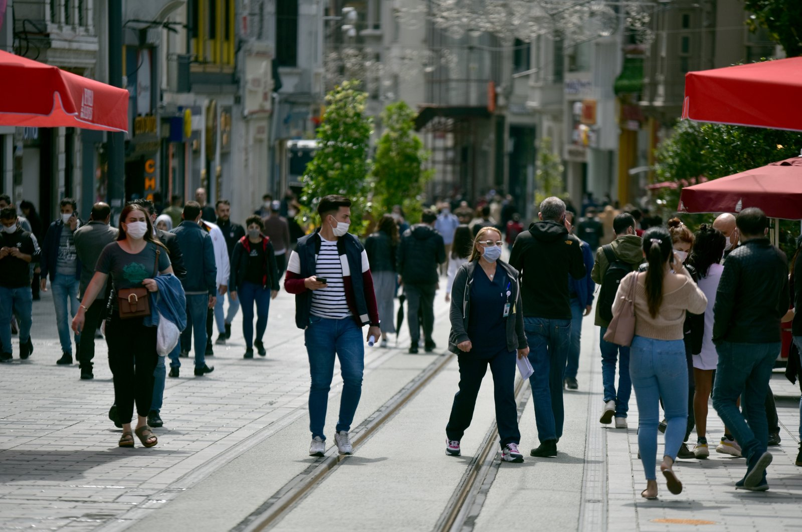 People walk on Istiklal Avenue as restrictions to stem the spread of the coronavirus are lifted across the country, Istanbul, Turkey, June 1, 2020. (DHA Photo)
