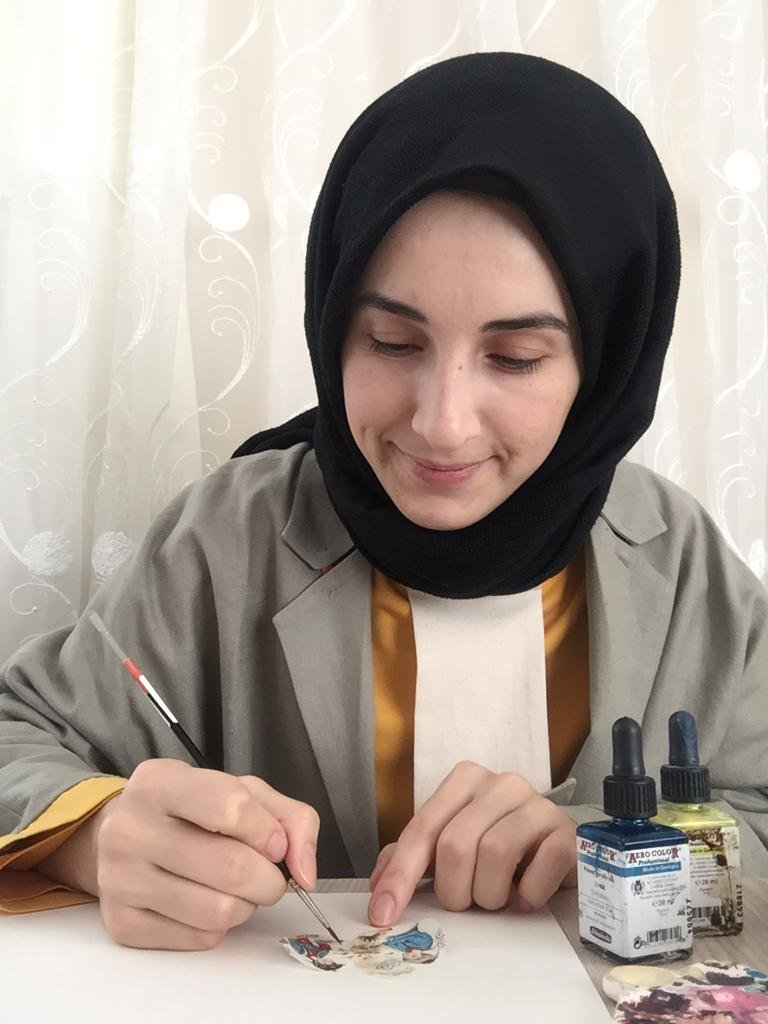 In this undated photo, Nevin Yapıcı works on a miniature in her house. (AA Photo)