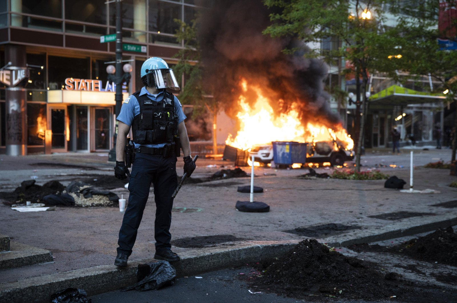 A Chicago Police Department SUV is set on fire near State and Lake in the Loop in Chicago, Illinois, U.S. May 30, 2020, as thousands of protesters joined national outrage over the death of George Floyd, who died in police custody on Memorial Day in Minneapolis. (Chicago Sun-Times via AP)