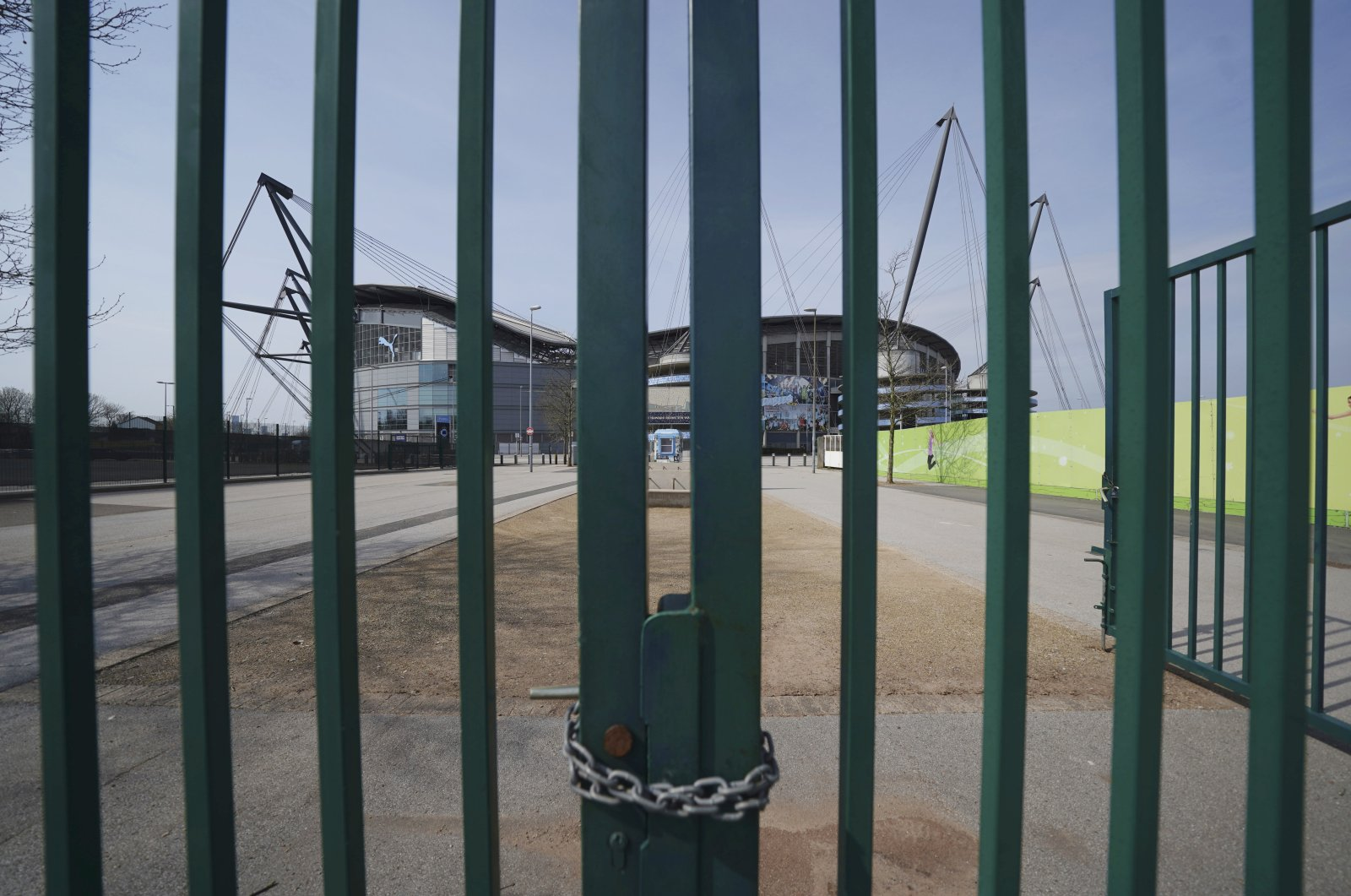 Gates stand locked outside the closed Manchester City Etihad Stadium, Manchester, England, April 9, 2020. (AP Photo)