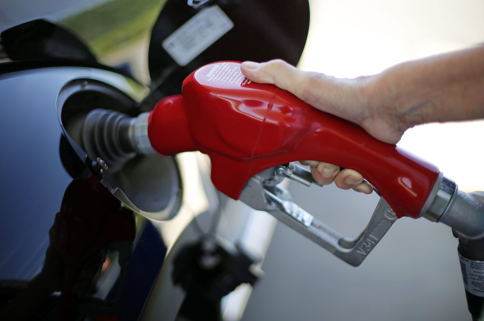 A woman fills her car with gasoline at a Costco gas station in Robinson Township, Pennsylvania, U.S., July 16, 2015. (AP Photo)