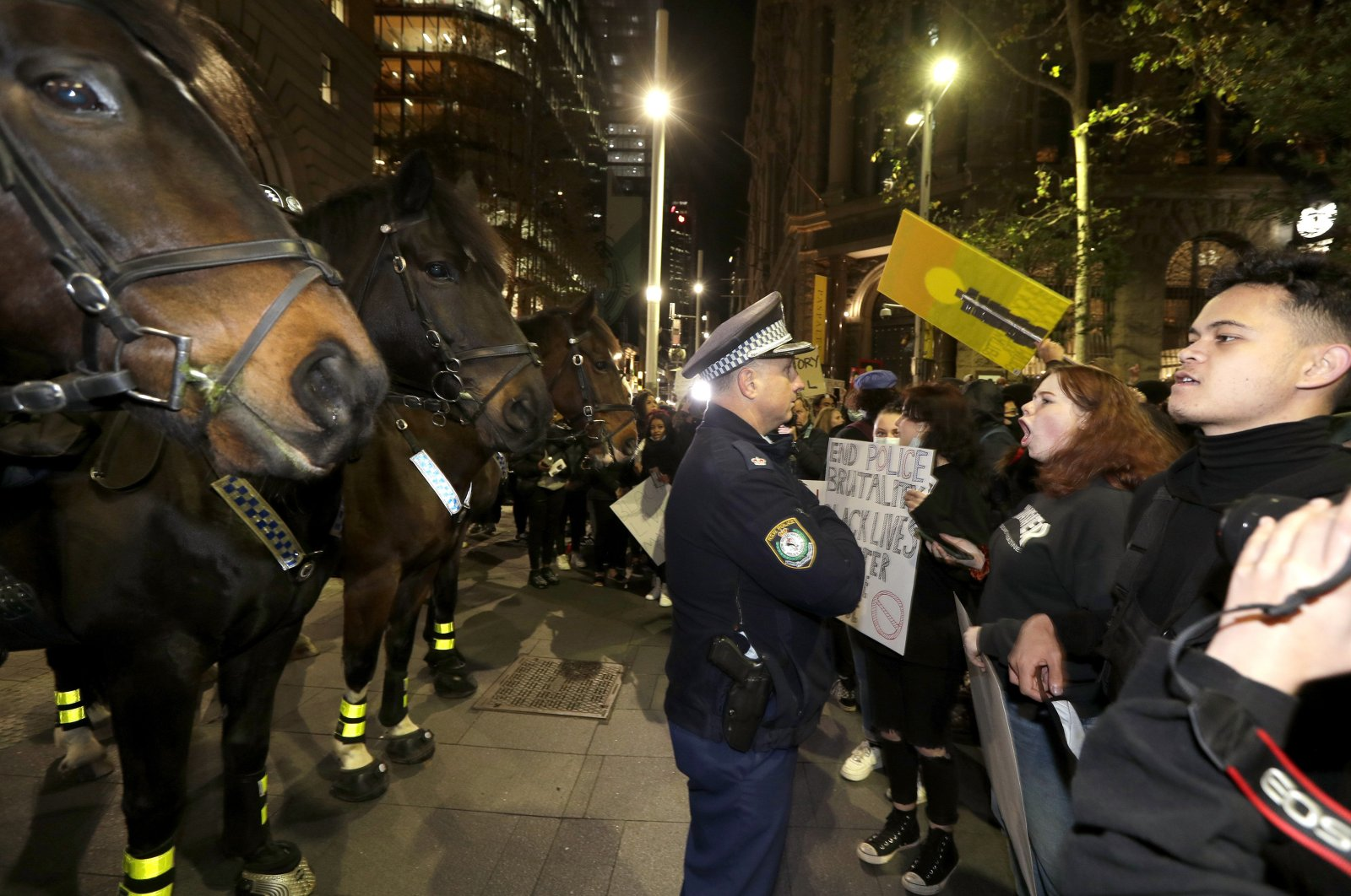 Protesters approach police on horseback as they gather in Sydney to support the cause of U.S. protests over the death of George Floyd, June 2, 2020,. (AP Photo)