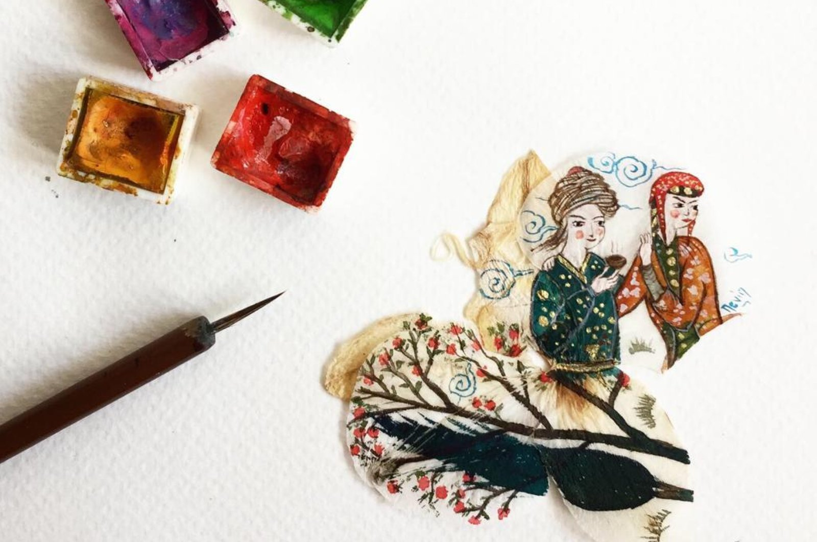 The art of miniature is actually finely crafted small paintings. (AA Photo)