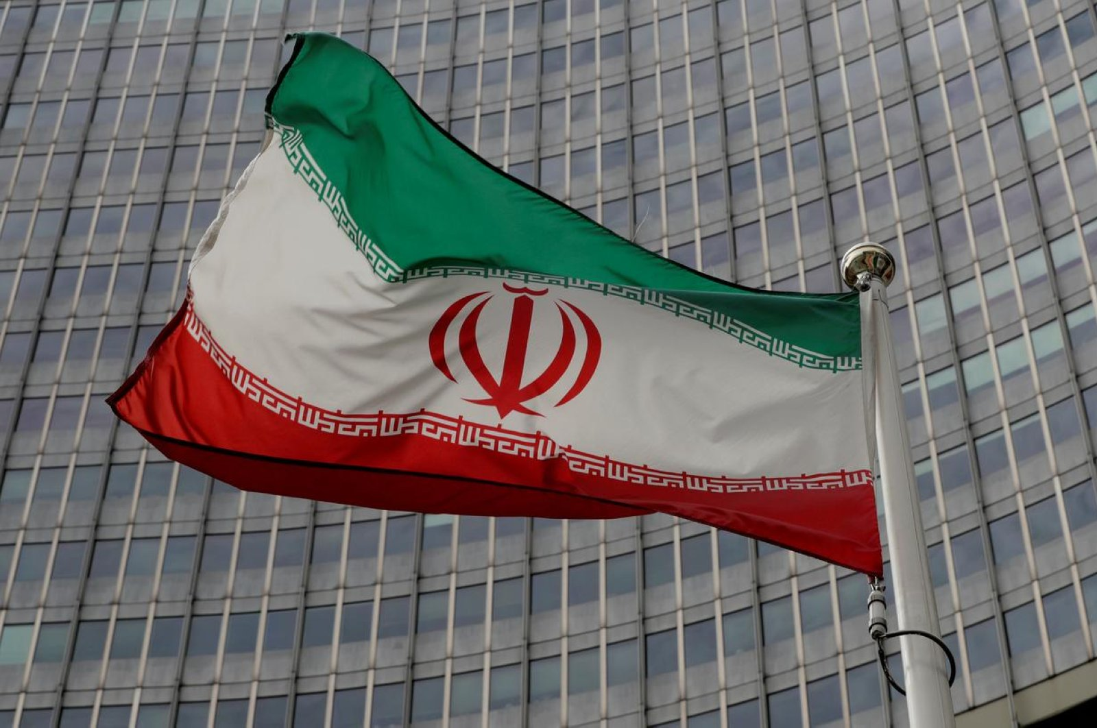 An Iranian flag flutters in front of the International Atomic Energy Agency (IAEA) headquarters in Vienna, Austria, Sept. 9, 2019. (Reuters Photo)