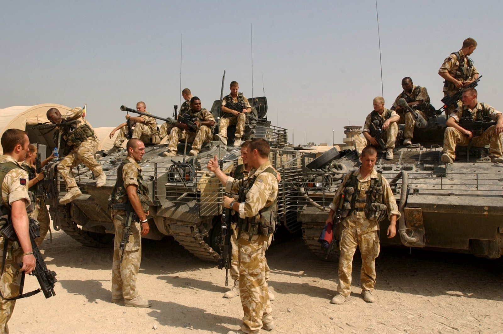 British soldiers stand by armored combat vehicles in Basra, 550 kilometers (340 miles) southeast of Baghdad, Iraq, Oct. 7, 2005. (AP Photo)