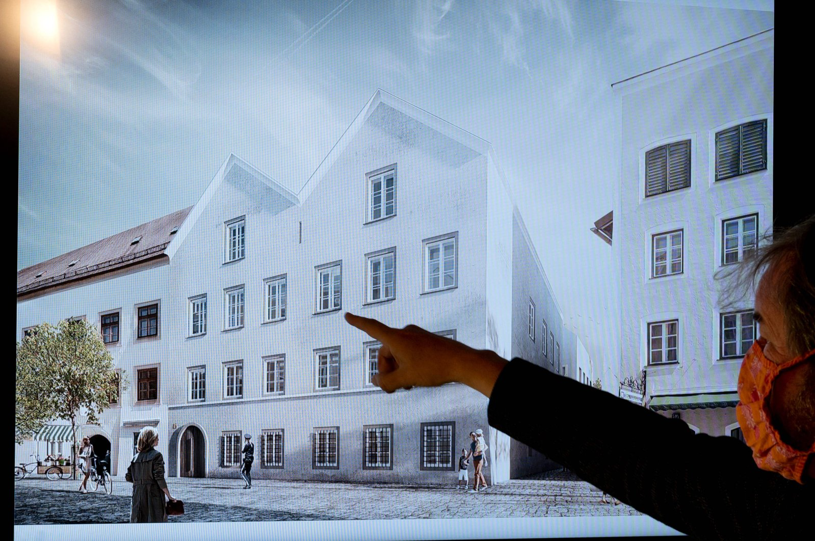A man points his finger at a screen showing the chosen plan for the architectural redesign of Adolf Hitler's birth house, during a press conference at the Interior ministry in Vienna, Austria on June 2, 2020. (AFP Photo)