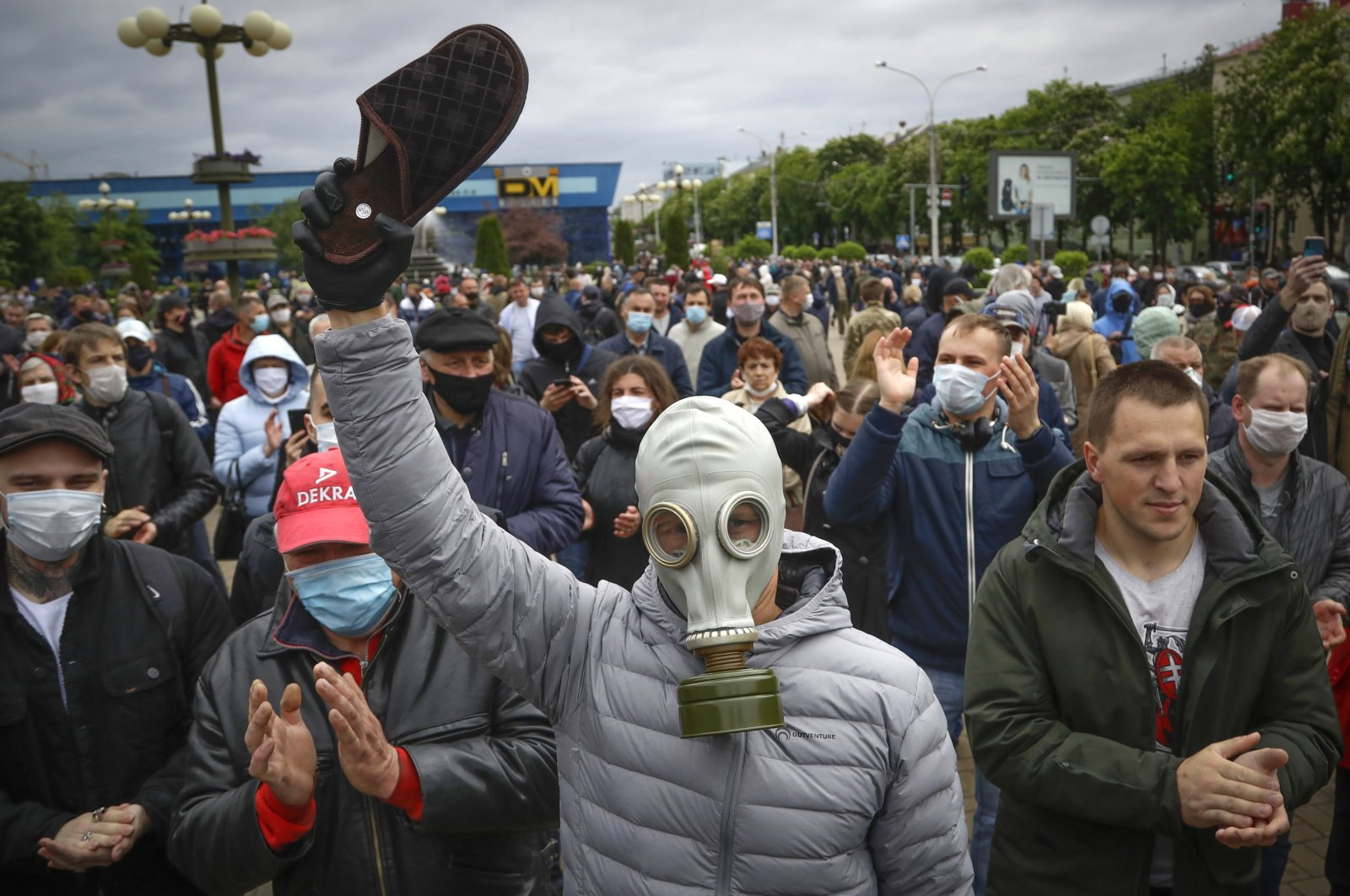 A man, wearing a gas mask to protect against the coronavirus, attends a rally to support for potential presidential candidates in the upcoming presidential elections in Minsk, Belarus, Sunday, May 31, 2020. (AP Photo)