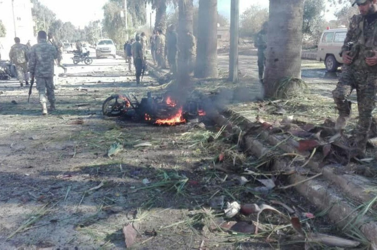 A file photo shows the carnage from a bomb-loaded vehicle attack by the YPG/PKK in Syria's Ras al-Ayn province that killed two civilians, Dec. 5, 2019. (IHA Photo)