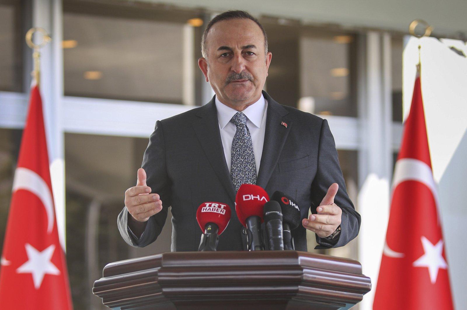 Foreign Minister Mevlüt Çavuşoğlu speaks to the media amid the coronavirus outbreak, in Ankara, Turkey, March 25, 2020. (AP Photo)