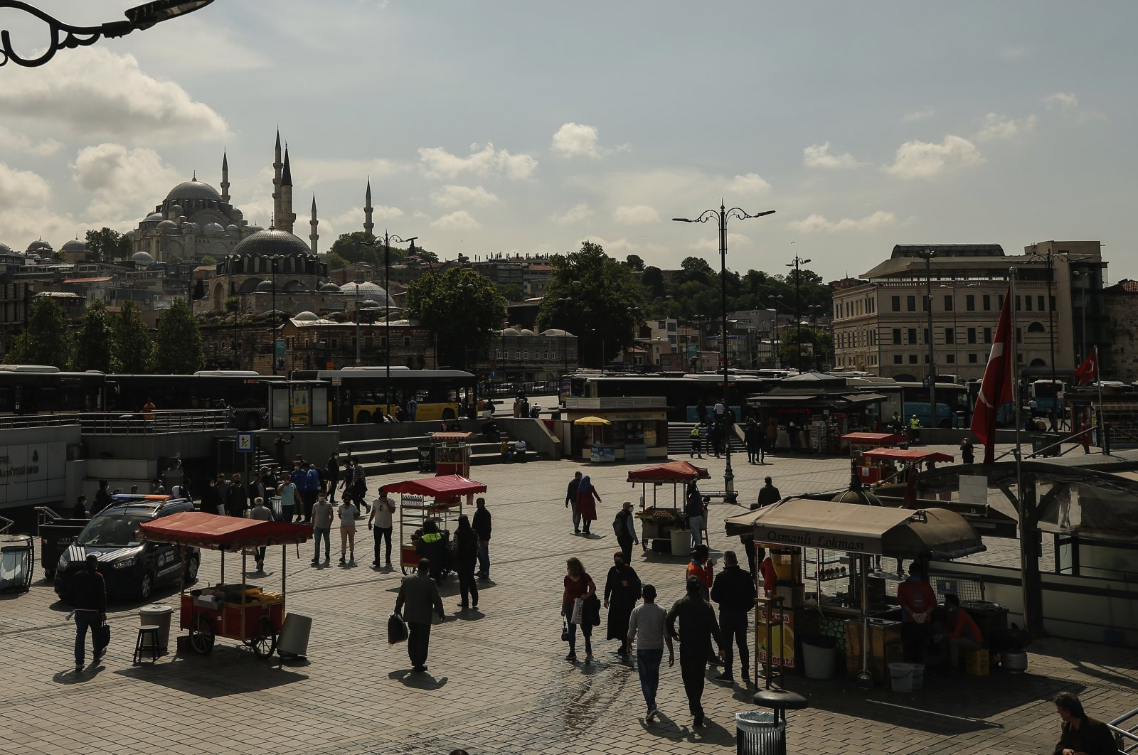 People walk in Istanbul, as shops reopen following weeks of closures due to the coronavirus pandemic, June 1, 2020. (AP Photo)