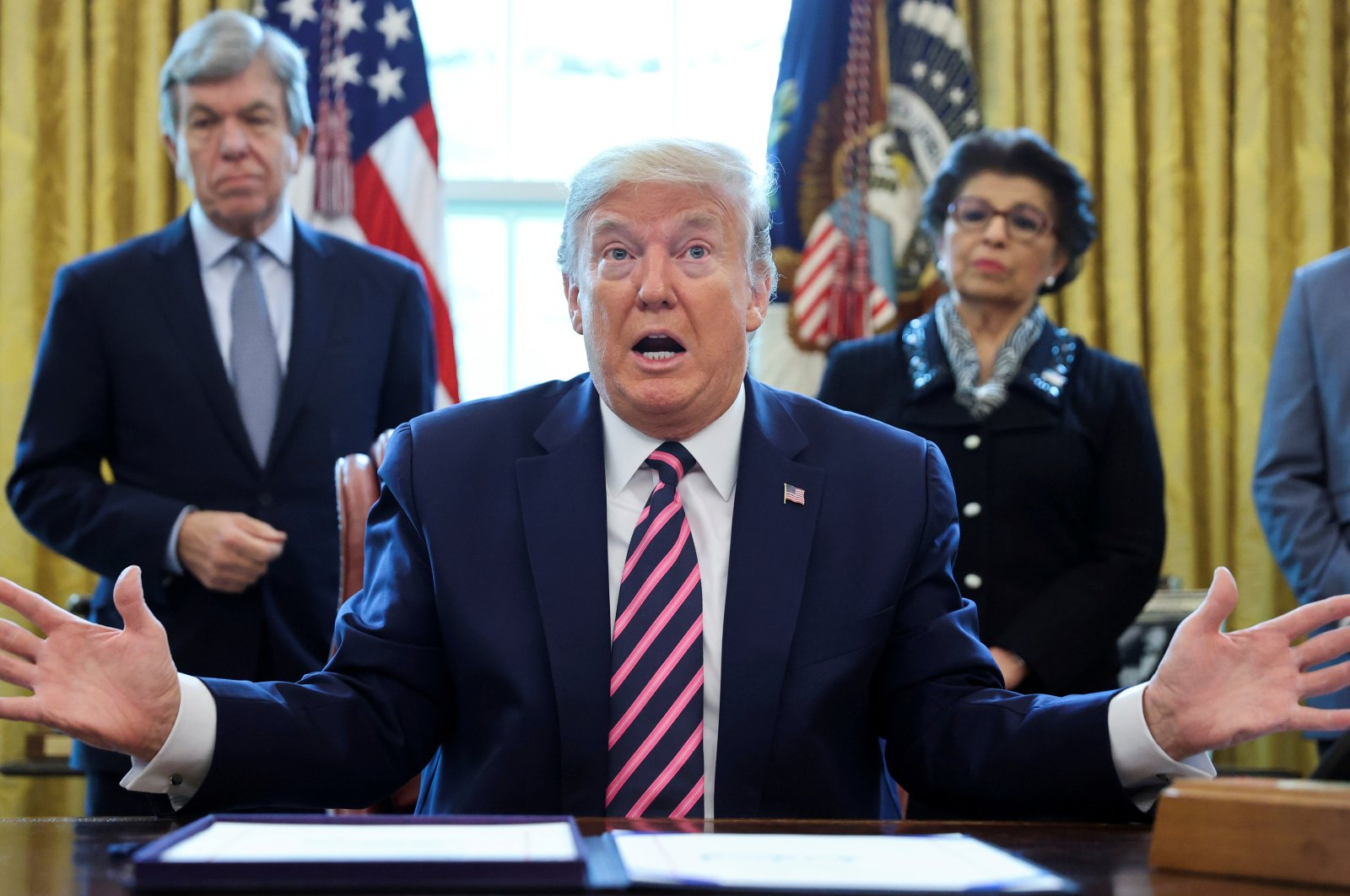 """U.S. President Donald Trump speaks to reporters during a signing ceremony for the """"Paycheck Protection Program and Health Care Enhancement Act,"""" approving additional COVID-19 relief for the U.S. economy and hospitals treating people sickened by the pandemic, in the Oval Office at the White House in Washington, U.S., April 24, 2020. (Reuters Photo)"""