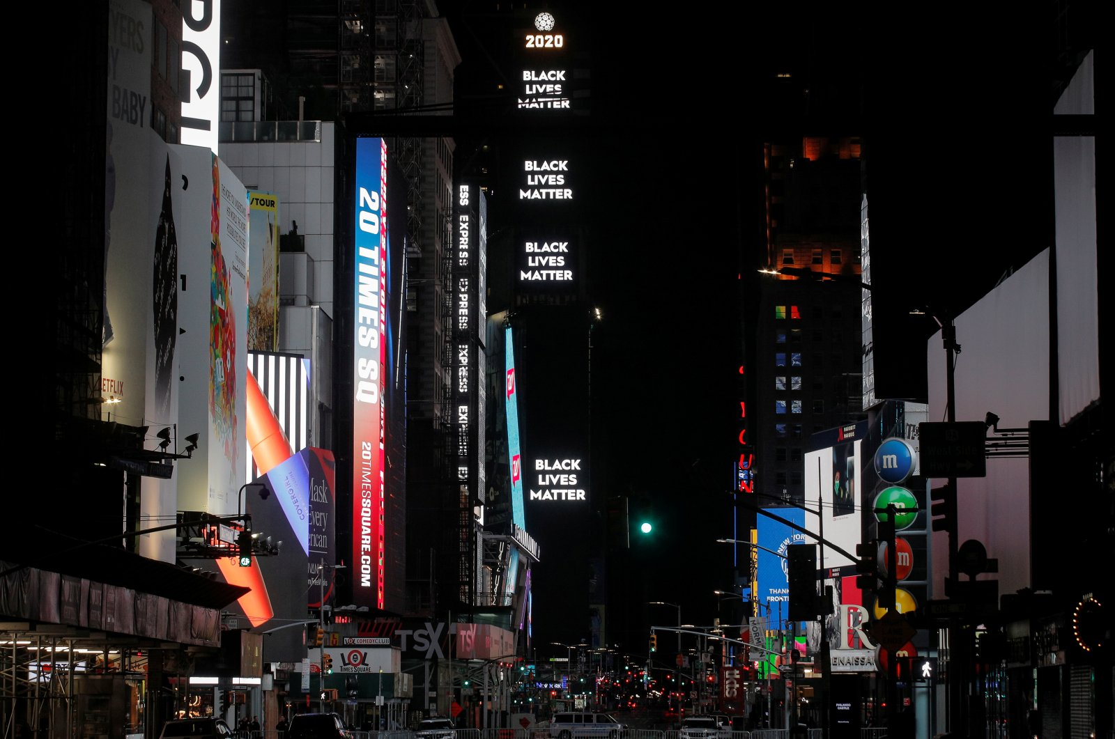 """Barricades and New York City Police vehicles block the entrance to Times Square, as a sign displays """"Black Lives Matter"""" after a curfew due to protests against the death in Minneapolis police custody of George Floyd, after curfew in the Manhattan borough of New York City, U.S., June 3, 2020. (Reuters Photo)"""