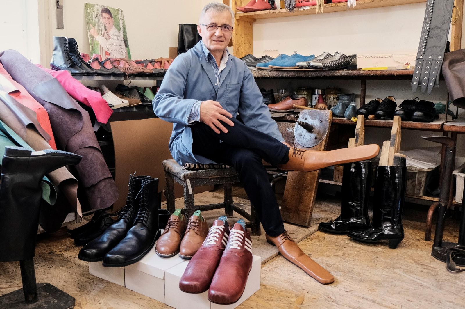 Romanian shoemaker Grigore Lup poses for a portrait while showcasing a pair of his long-nosed leather shoes to help keeping social distance, amid the outbreak of the coronavirus, in Cluj-Napoca, Romania, May 29, 2020. (Inquam Photos via Reuters)
