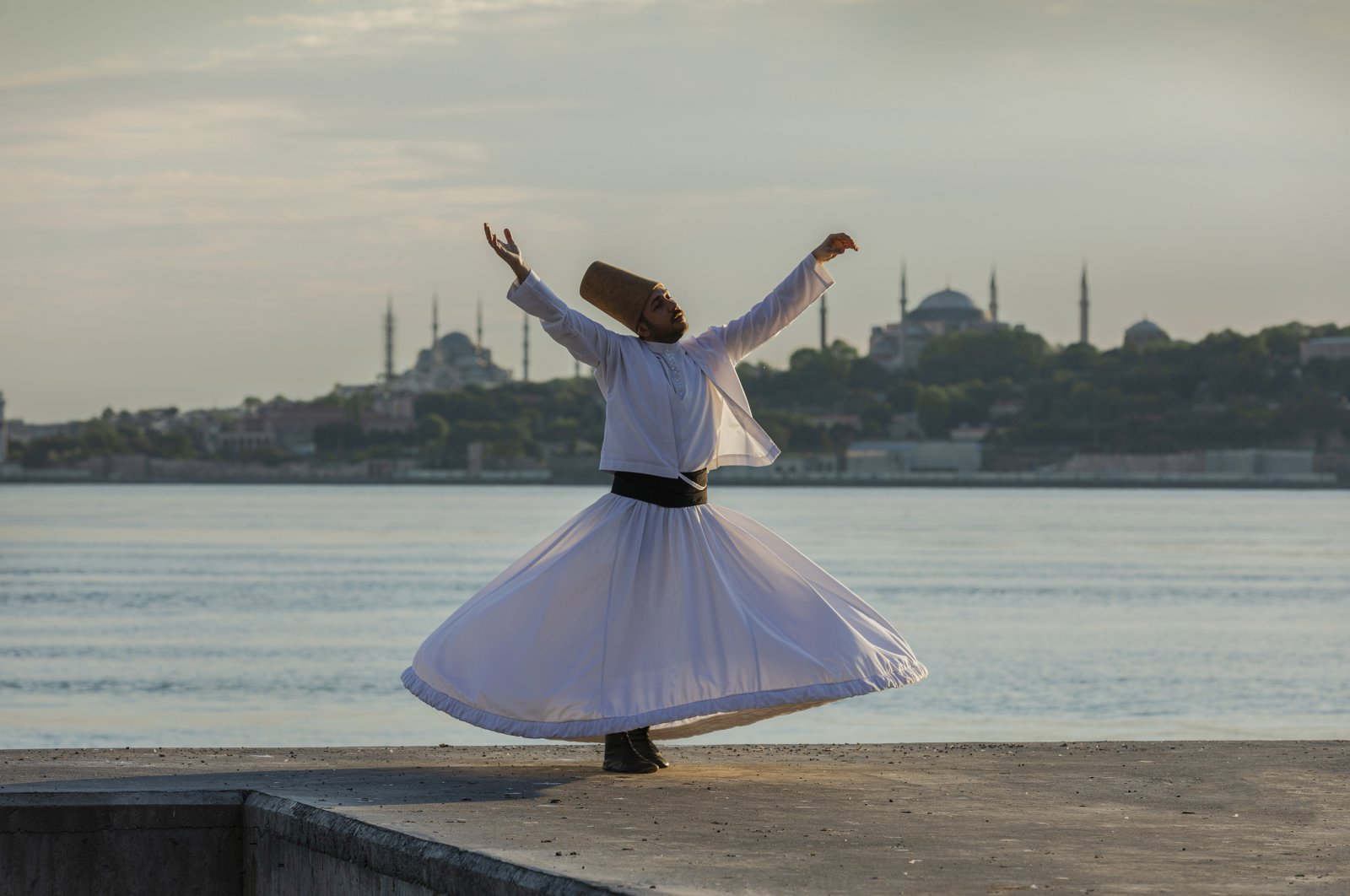 In the video clip, whirling dervish Ismail Ecevit performs his show with a backdrop of Istanbul's iconic sites. (AA Photo)