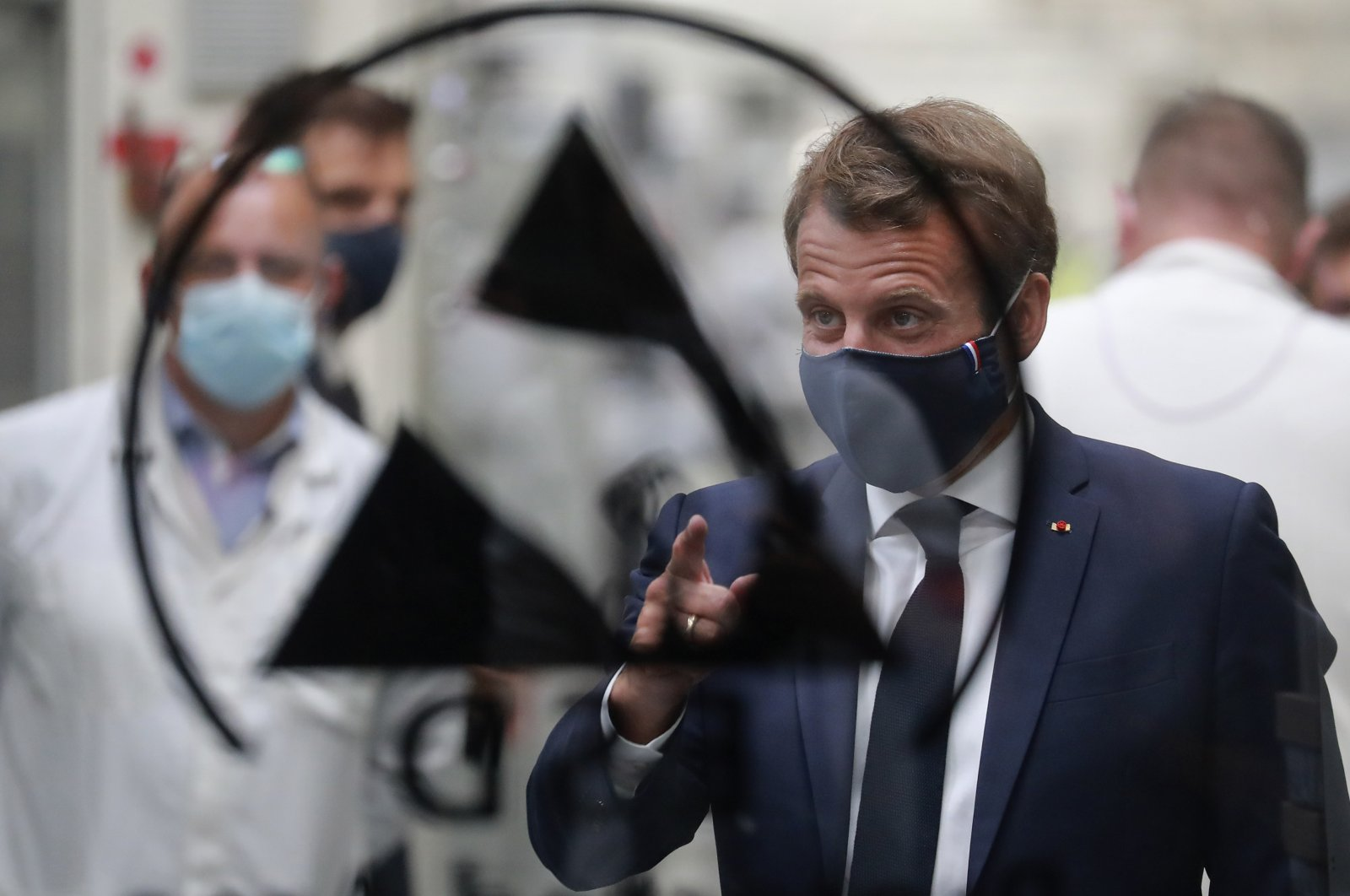 French President Emmanuel Macron wears a face mask during his visit to Valeo's manufacturing plant, in Etaples, northern France, May 26, 2020. (AP Photo)