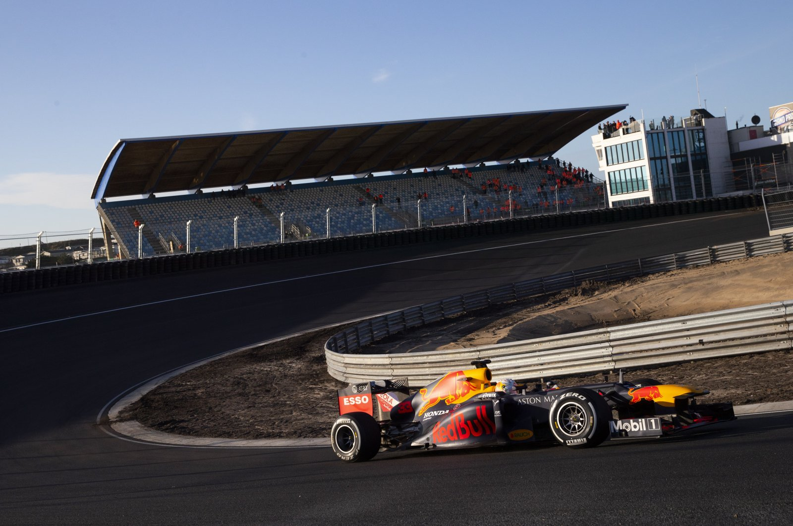 F1 driver Max Verstappen drives his car through one of the two banked corners during a test and official presentation of the renovated F1 track in Zandvoort, Netherlands, March 4, 2020. (AP Photo)