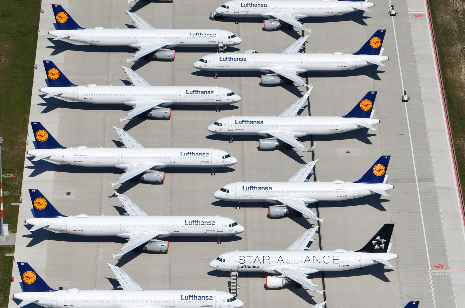 An aerial view shows aircraft of Lufthansa sitting on the tarmac at the Berlin Brandenburg International Airport in Schoenefeld, Germany, April 23, 2020. (EPA Photo)
