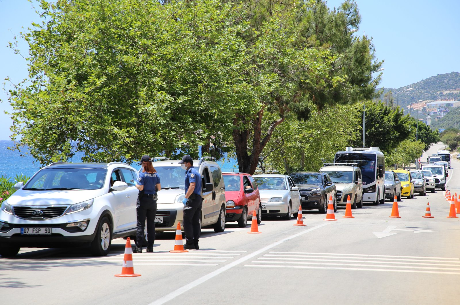 Police inspect vehicles entering Kaş district, in Antalya, Turkey, June 2, 2020. (İHA Photo)
