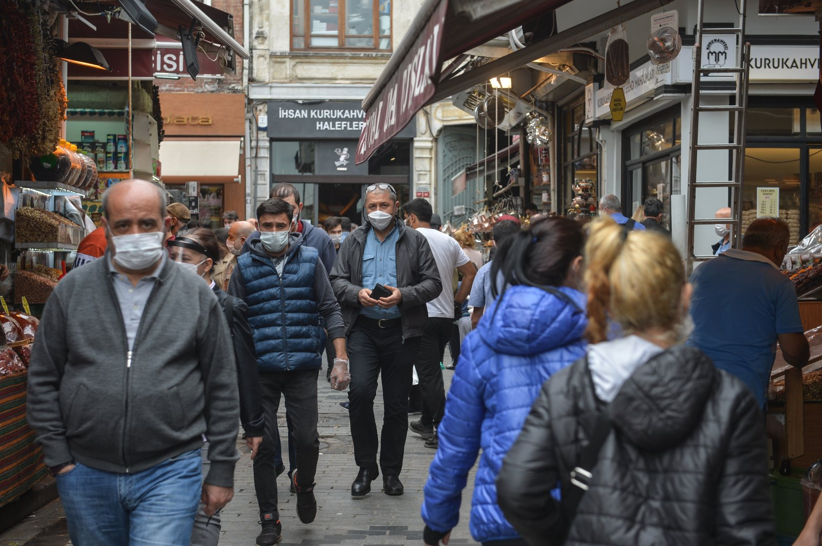 People wearing protective masks walk in a marketplace, in Istanbul, Turkey, June 3, 2020. (DHA Photo)