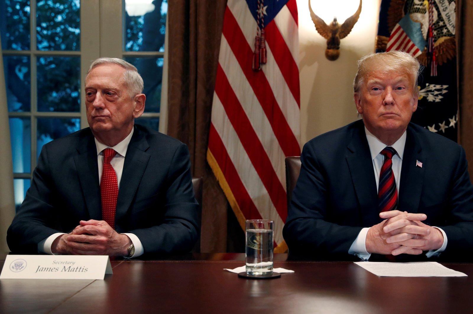U.S. Defense Secretary James Mattis, left, sits next to U.S. President Donald Trump during a briefing with senior military leaders in the Cabinet Room at the White House in Washington, Oct. 23, 2018. (Reuters Photo)