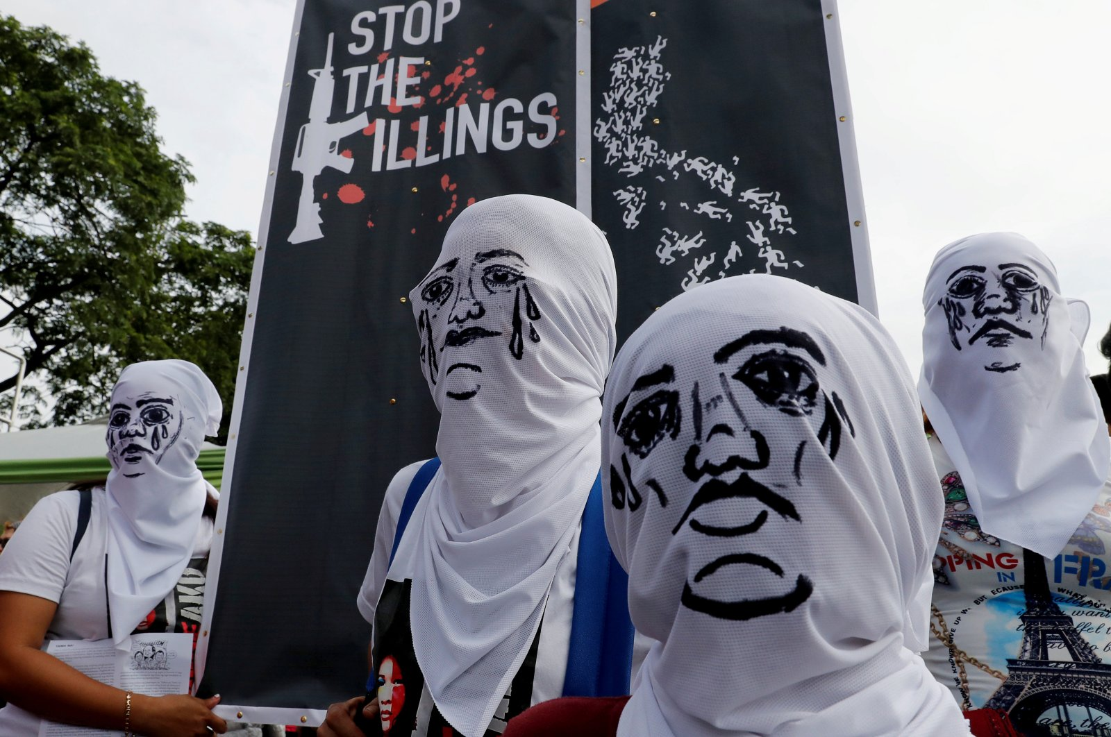 Activists wear hoods depicting families of victims killed in President Rodrigo Duterte's drug war as Duterte delivers his State of the Nation address in Quezon City, Metro Manila, Philippines, July 23, 2018. (Reuters Photo)