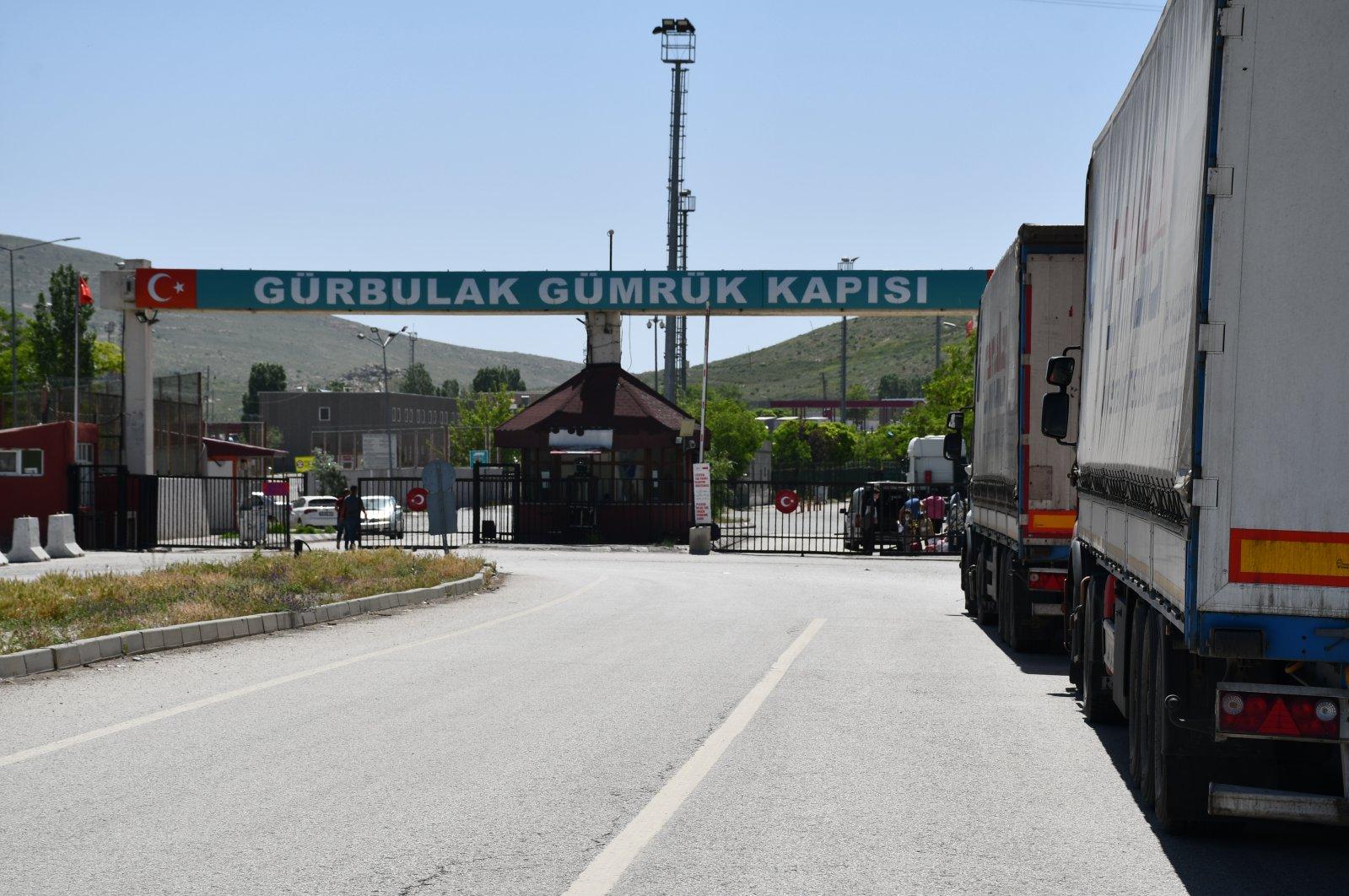 Trucks are seen at the Gürbulak border gate in eastern Turkey's Ağrı province along the Iranian border, June 4, 2020. (AA Photo)