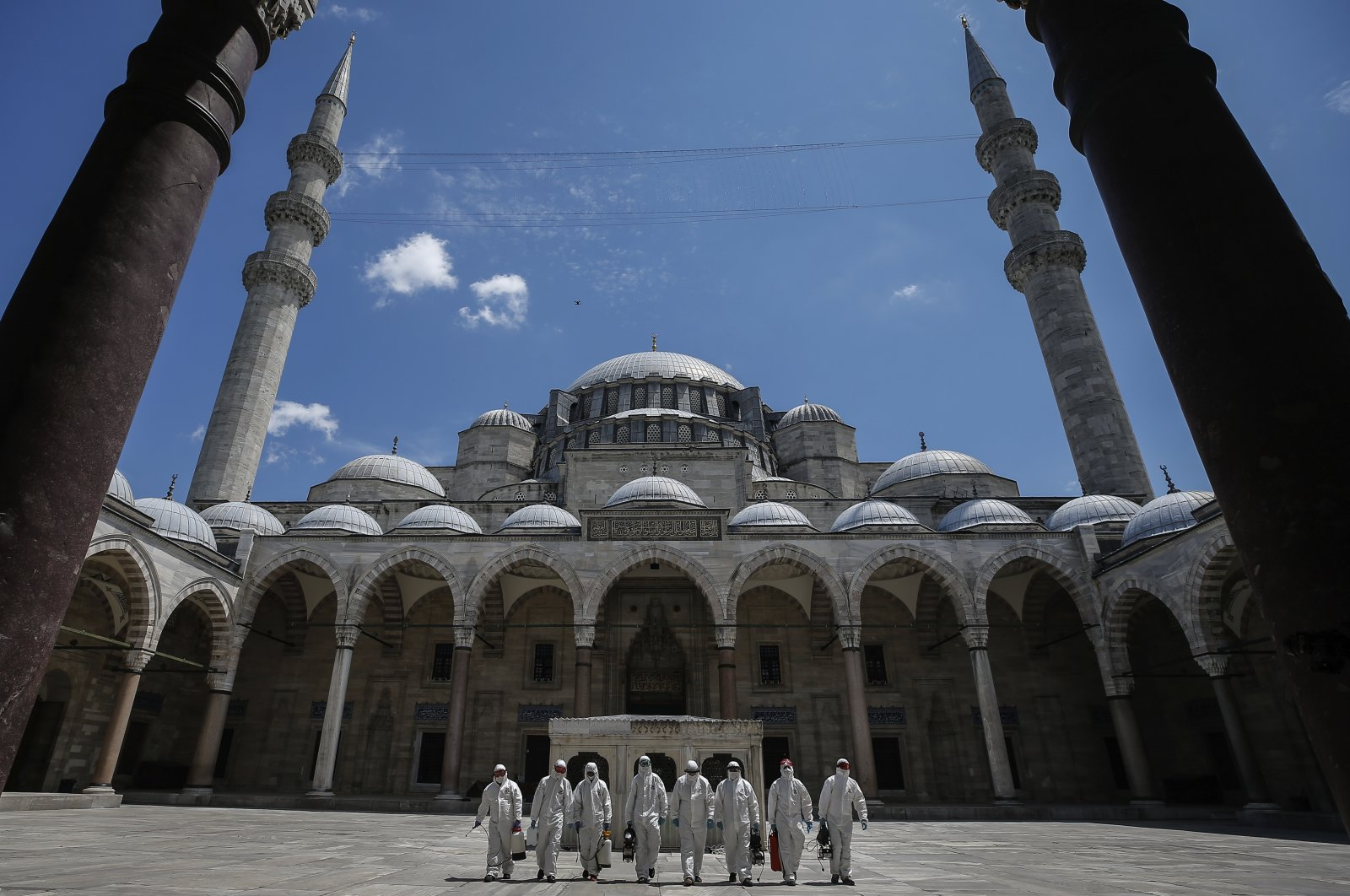 Municipality workers disinfect the grounds of the historical Süleymaniye Mosque, Istanbul, Turkey, May 26, 2020. (AP Photo)