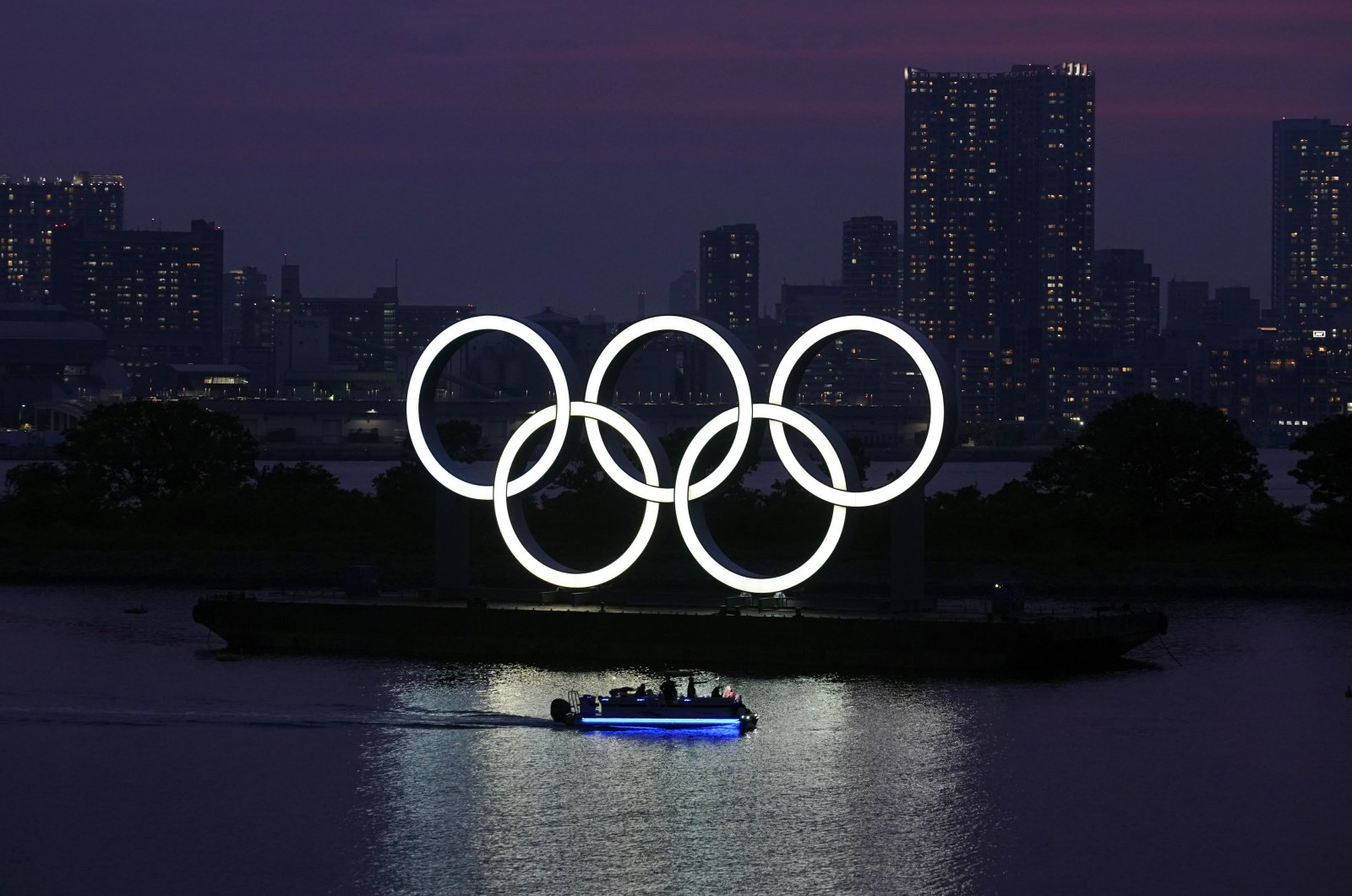The Olympic rings float in the water at sunset in the Odaiba section in Tokyo, Japan, June 3, 2020. (AP Photo)