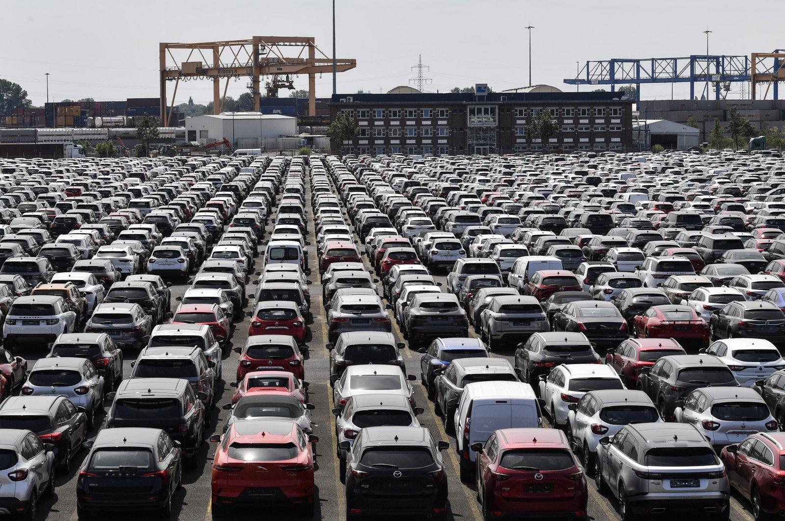 New cars are stored at a logistic port in Duisburg, Germany, June 3, 2020. (AP Photo)